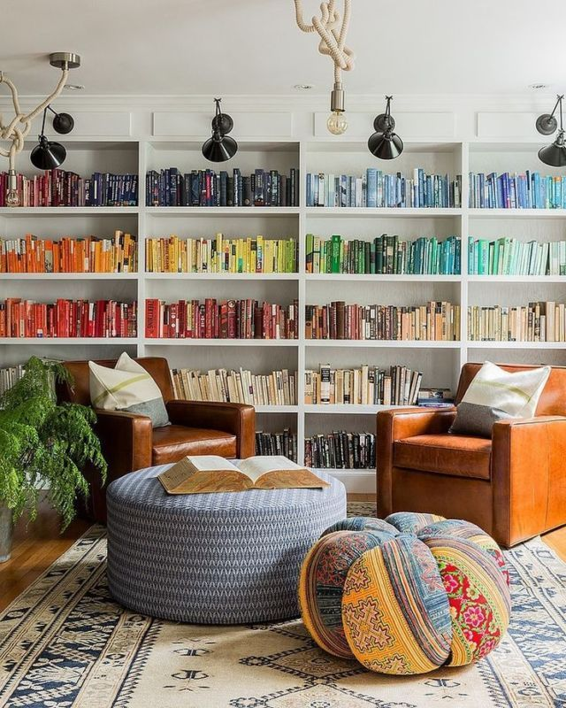 Organizing bookshelves by book cover color makes for a gorgeous visual display. If you don't want to commit to this organization method for your entire library, try it with only part of your collection in the kitchen or bedroom.