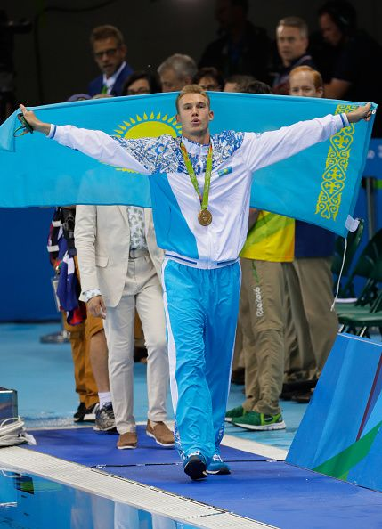 #RIO2016 Gold medalist Dmitriy Balandin of Kazakhstan celebrates during the medal ceremony for the Men's 200m Breaststroke Final on Day 5 of the Rio 2016...