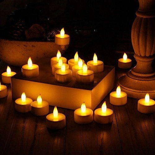 Stunning Flameless LED Tea Light Candles - Realistic Battery-Powered Flameless Candles - Beautiful and Elegant Unscented LED Candles - The Perfect Decoration - (24 Pack) - Fake Candles - Divine LEDs Divine LEDs