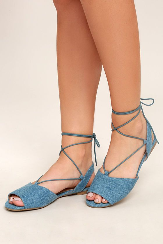 Head to brunch with your best gal pals in the Crissy Light Blue Denim Lace-Up Peep-Toe Flats! Denim fabric covers these cute peep-toe flats with a sling back design, and long tying laces.