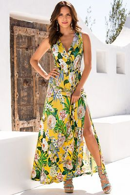 Because you want to make an impression, wear this eye-catching tropical bouquet maxi dress with a surplice neckline, effortless drawstring elastic waistline and a sexy side sl