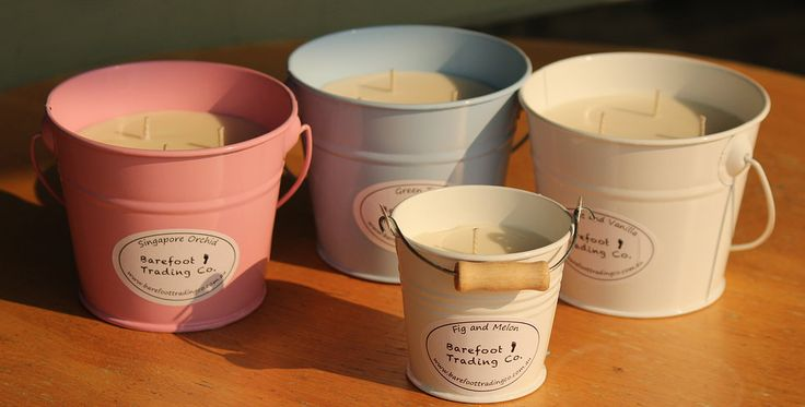 All our candles are handmade with soy wax and natural scents. They are long lasting, and they come in these cute buckets!