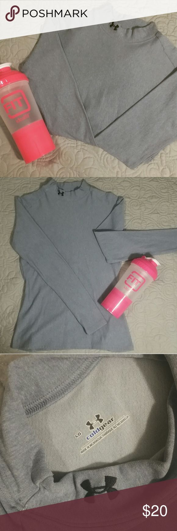 Under Armour fitted shirt Light grey long sleeve shirt. Cold gear by Under Armour. Always worn under snowboarding gear so there's no stains or flaws. Size large, but I typically wear a small and it's still a fitted wear on me. Feel free to make an offer! Under Armour Tops Tees - Long Sleeve