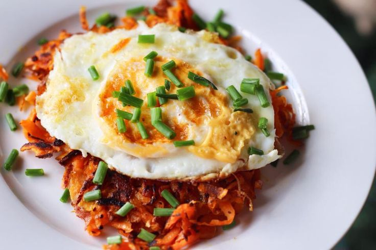 Sweet potato hash (seasoned with yummy herbs and spices) topped with a fried egg and chives.