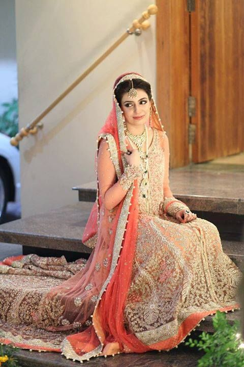 Gorgeous peach, ivory, silver and gold Pakistani wedding gown worn with heirloom antique gold, pearl and emerald jewellery.