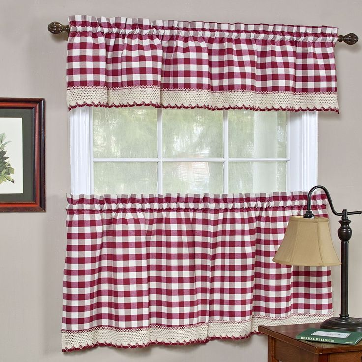 Accent your home with this charming curtain set or separates. Crafted with cotton blend, this embellished curtain set or separates features a check pattern in white and red tones.