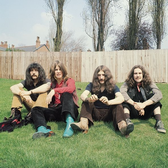 The first Black Sabbath picture - taken by original manager Jim Simpson in 1968 of Tony Iommi, Ozzy Osbourne, Geezer Butler, Bill Ward sitting on a grass bank close to Portland Road, Edgbaston