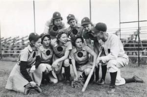 Bill Allington, manager, with members of the AAGPBL Rockford Peaches, the team he coached in 1945 and 1948-1950, leading them to win the League playoff championships each year.
