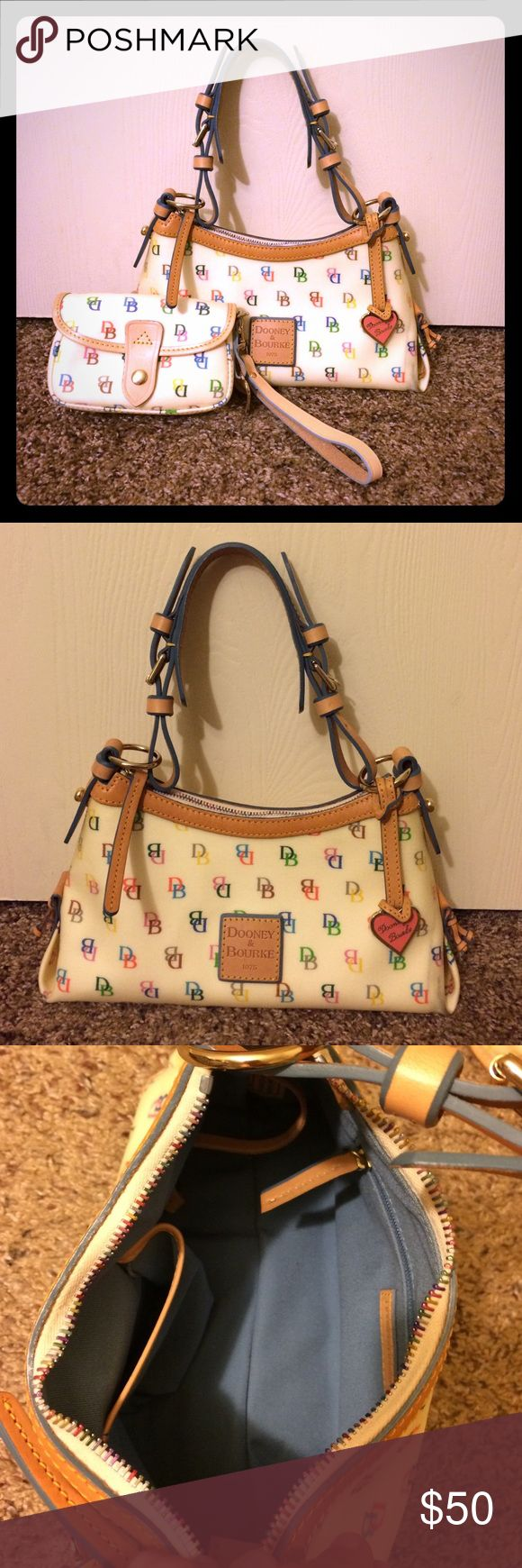 "Authentic Dooney & Bourke purse and wristlet 100% authentic! Purse is in excellent like new condition except for a dark mark on the right hand corner(shown in picture). The inside is pristine! The wristlets is in absolute pristine condition. Has original tag with it. Comes from a smoke free home, no odors. Both are beautiful pieces! Bundles are discounted! Purse dimensions are 11"" wide and 6"" tall. Wristlet is 6"" wide and 4"" tall. Dooney & Bourke Bags"