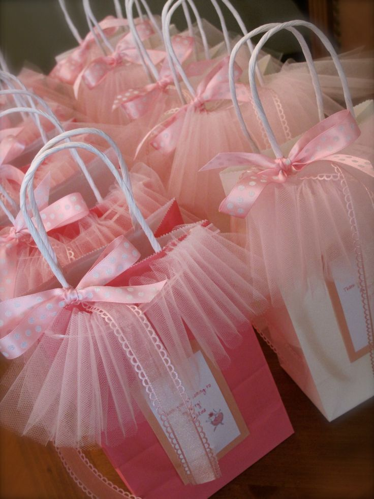 "Adorable Girl's Party Tutu Bags ! Gather a strip of tulle with 1/8"" ribbon, hot glue ends to 5x7"" gift bags; then tie coordinating ribbon at base of handle !"