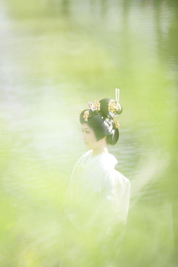 "A Japanese Bride dressed in the traditional white Kimono ""Shiromuku"" shown during the Heartland Kurashiki 2012 during Golden Week.   The event was held in the Kurashiki Bikan historical quarters in Okayama, Japan."