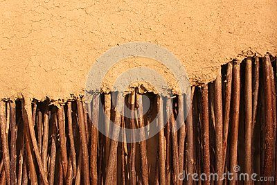 Details by wall of twigs wrapped in clay
