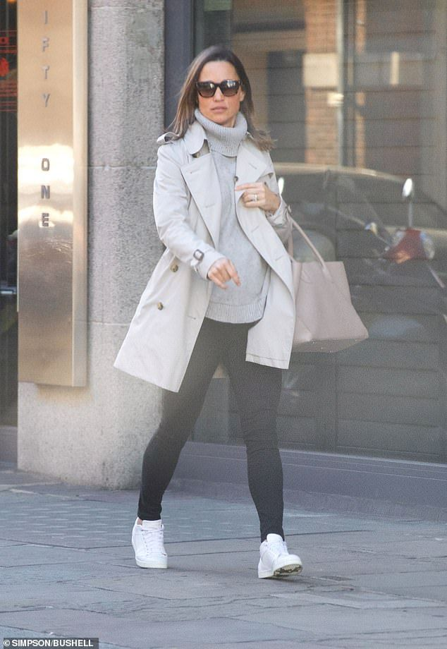 95f24e5760184 Kate's sporty younger sister looked chic in black jeans, a chunky grey  knit, a trench coat and trainers on Wednesday, for a visit to her  Kensington gym