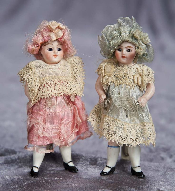 """3.5"""" (9 cm.) Pair, German All-Bisque Miniature Dolls with Matching Original Costumes 400/600"""
