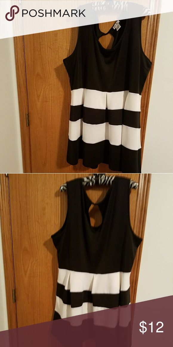 Cute black and white skater dress Wet Seal plus sleeveless skater dress.It is a mini dress and it's never been worn,but no tags are attached. Wet Seal Dresses