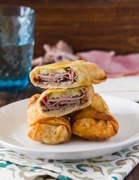 Crispy cuban egg rolls made with pickles, roast beef, ham, swiss cheese, mustard an outer crispy shell.