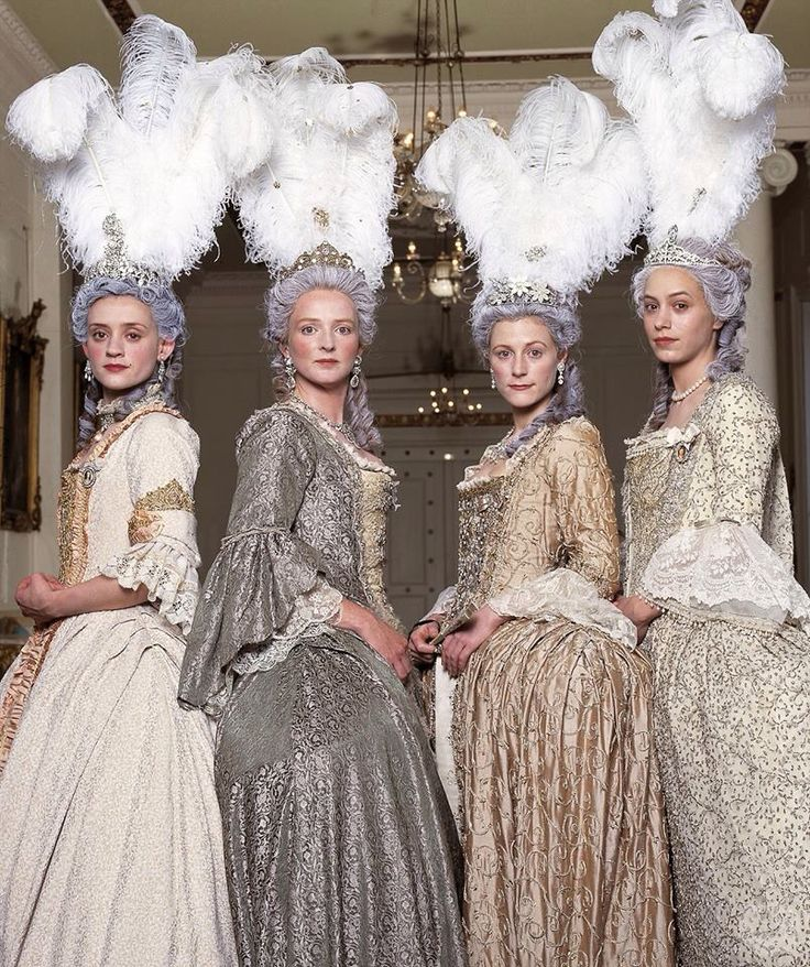 Court gowns with ostrich feather headdresses