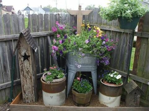 Love this idea for a section with a similar layout in our backyard.......I'm thinking red geraniums would really pop against the aged metals!