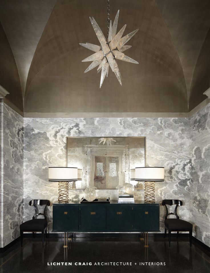 Lichten Craig's foyer is a modern take on a traditional room, with a graphic wall treatment and rock crystal chandelier that add interest to the rigorous symmetry of the space.