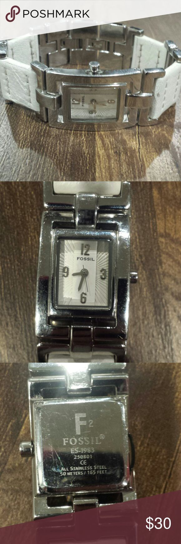 White and Silver Fossil Watch This is a used watch and needs a new battery. The silver part has some scratches. Box is not included. Fossil Accessories Watches