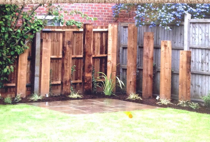 Upright railway sleepers introduce height and define the edge of the terrace while planting softens the hard lines