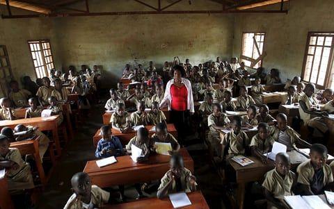 A teacher leads a class at the École Primaire Avé Maria