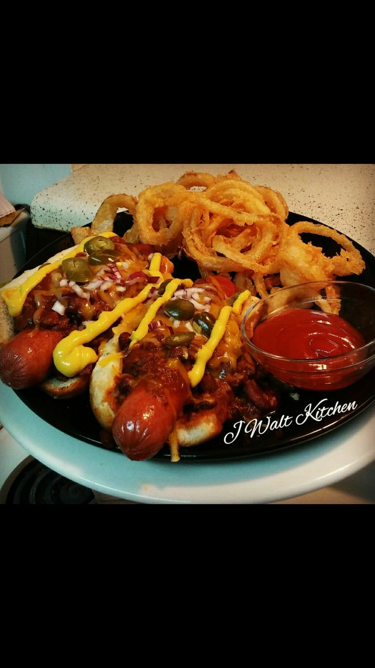 Nathan's Beef Hotdogs Topped w/ Jalapeños, Diced Red Onions, Cheddar Cheese, Chilli Sauce & Onion Rings (J. Walts Kitchen) Marietta, GA