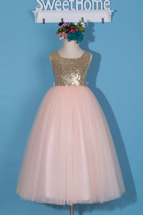This beautiful gold sequin and pink tulle flower girl dress takes glamour to an extreme as it comes with stylish embellishments. This sleeveless dress has a gold sequin embellished bodice, makes your little girl sparkling under both sunshine and party lights. The elegant deep V back pairs with matched beautiful blush pink bow. The skirt comes with beautiful blush pink multiple layer tulle in ankle-length and is lined with comfortable high quality same color satin. All the details of the…