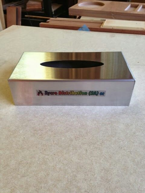 Stainless steel tissue box covers.