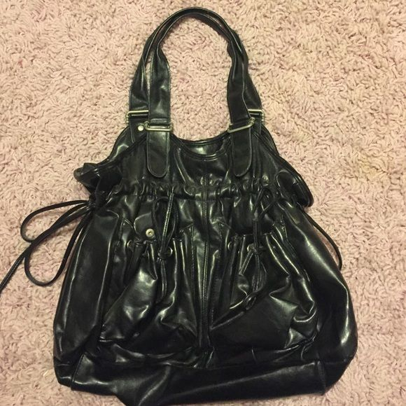 Black Scrunchy Tie Purse black medium-large scrunchy purse with side ties, 2 front pockets with scrunchy ties, and inside pockets. in great condition! Fashion Express Bags Shoulder Bags