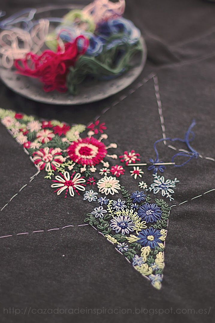 she embroiders this star on a simple t-shirt,