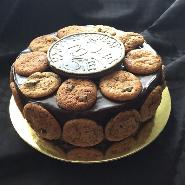 Vegan Chocolate Mucake  Decadent chocolate mud cake covered in chocolate ganache and decorated with choc chip cookies. Finished with a hand made chocolate plaque