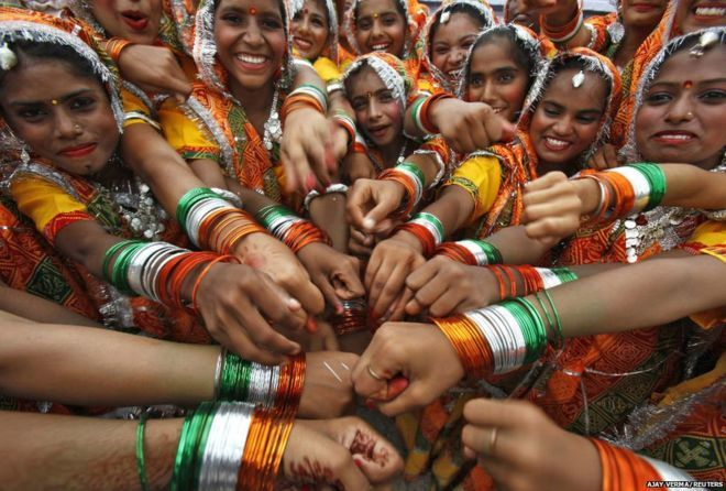 Schoolgirls gather outside after their cultural programme to celebrate Indian Independence Day in Chandigarh, Punjab