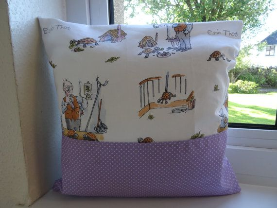 Beautiful hand made cushion cover featuring Esio trot fabric in the background and a pocket made from quilters weight purple polka dot cotton pocket.