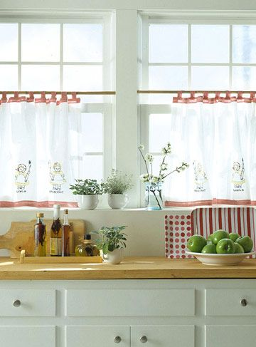 Tab-Top Cafe Curtains from Vintage Towels  Hung on tension rods so they just skim the windowsill, these cafe curtains filter light, provide privacy, and add vintage charm to the kitchen.