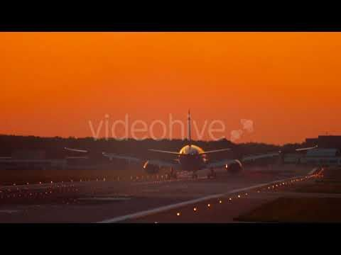 Airplane Landing at the Early Morning (Stock Footage)