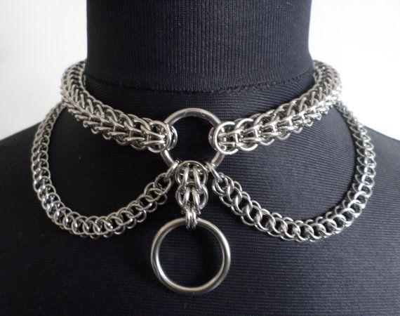 Heavy Duty Chainmaille O-Ring Choker  Handcrafted using 16 gauge stainless steel chainmail rings weaved using the full-Persian chainmail pattern. The main collar is supported by two chainmail draped chains weaved in the half-Persian chainmaille pattern, crafted using smaller 7mm chainmail rings. The choker is completed with two marine grade stainless steel O-Rings to the front and either a secure alloy box padlock or heavy duty snap clasp to the back.  The custom size selected indicates the…