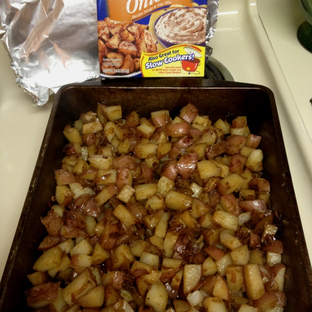 Lipton Onion Soup Potatoes, recipe is on the box: 7-10 new potatoes diced, a little olive oil and one packet of soup mix. Cover with foil and bake at 350 for 45 minutes.