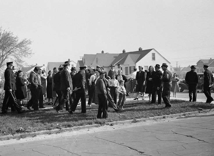 Detroit police disperse white picketers who objected to occupancy by blacks of Sojourner Truth Federal housing project, erected in a predominately white neighborhood, on April 29. 1942.