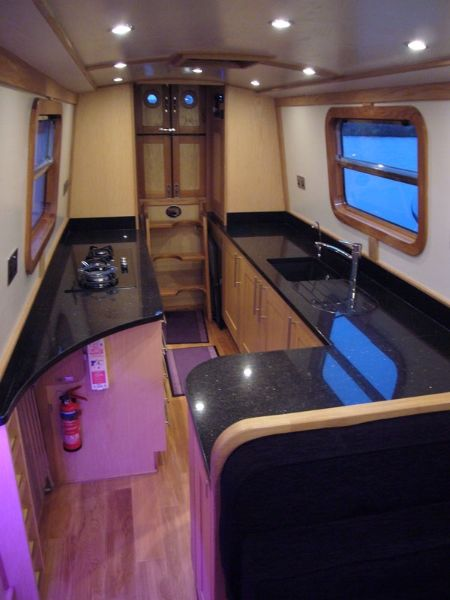 Slick, modern galley by Aqua Narrowboats - like layout not materials. Under counter lights are cool but how much would they cost to run? Like LED spots in roof