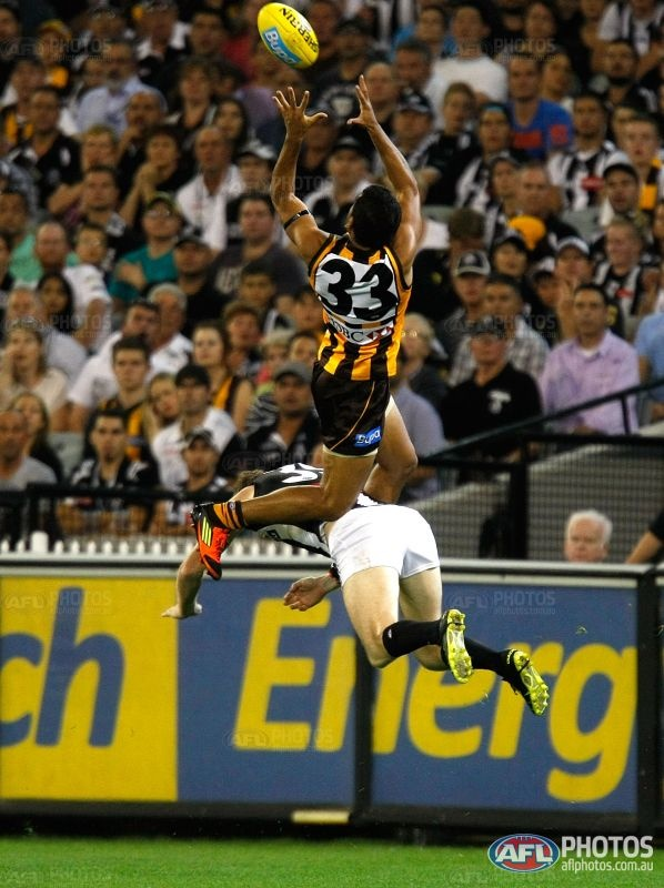footy - a mark - one way to keep warm in the winter  Cyril Rioli, AFL.