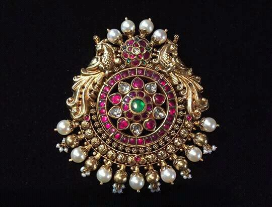 You can never beat old designer jewelry.... This piece is used mainly by Bharatnatyam dancers and also used for wedding hairdo....