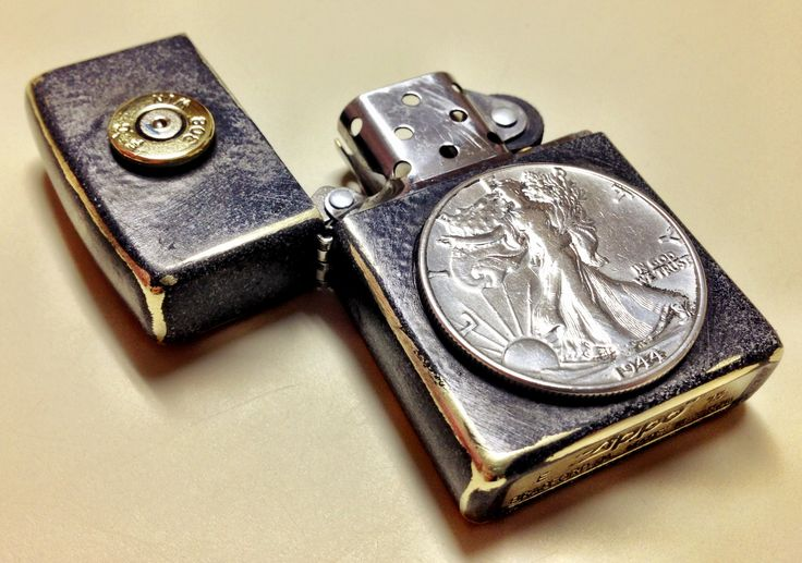 Custom Zippo:  Features a distressed finish, genuine 1944 Walking Liberty Half Dollar, and a .308 Winchester inlay.  Price for this one-of-a-kind zippo is $75.00