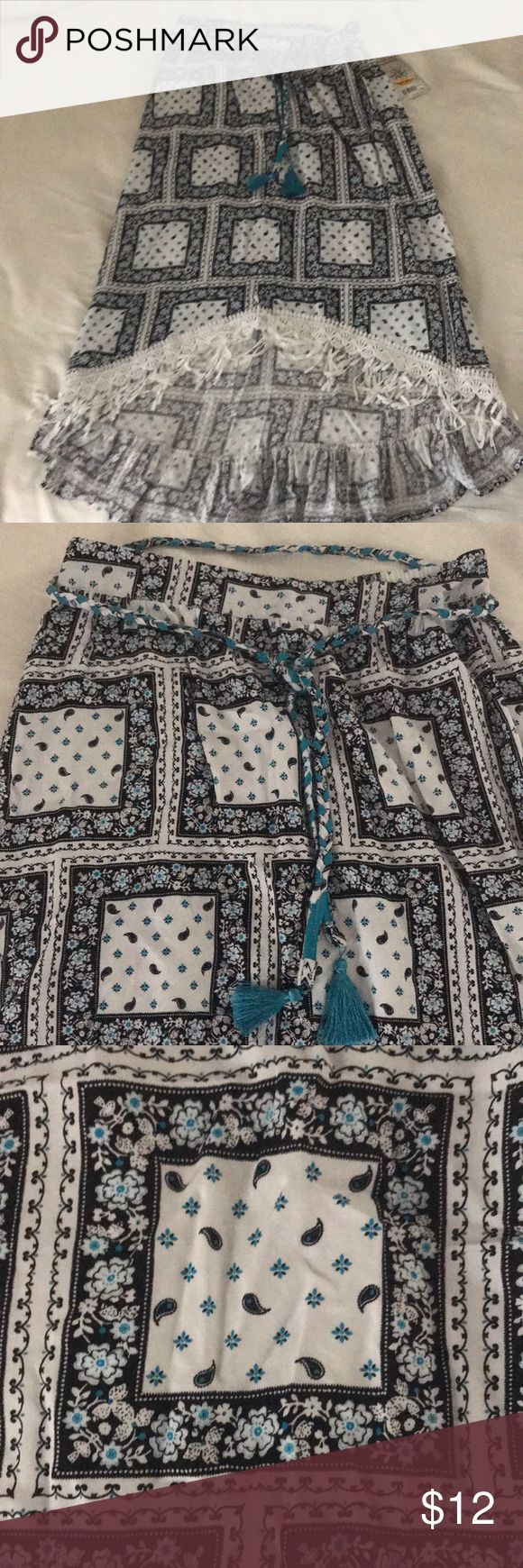 D signed high low skirt sz 10/12. NWT. D-signed high low skirt. Belt around waist with tassels on end. Ruffled bottom of skirt. NWT. White, black and turquoise. Disney Bottoms Skirts