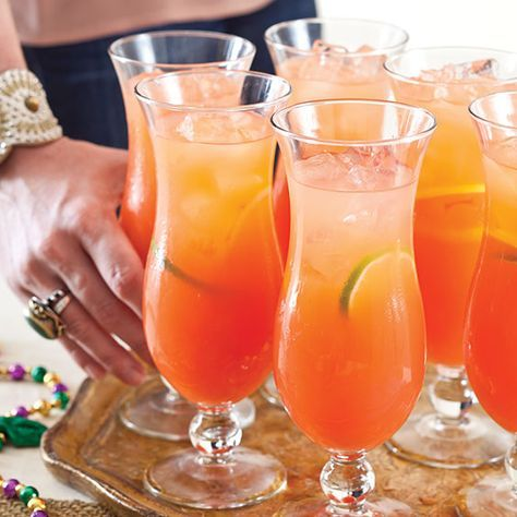 hurricane punch 1(46-ounce) can pineapple juice 5½cups orange juice 1½cups white rum 1cup lemon-flavored rum 1cup grenadine ½cup lime-flavored vodka  Stir all ingredients in large pitcher. Garnish: lemon, lime, and orange slices