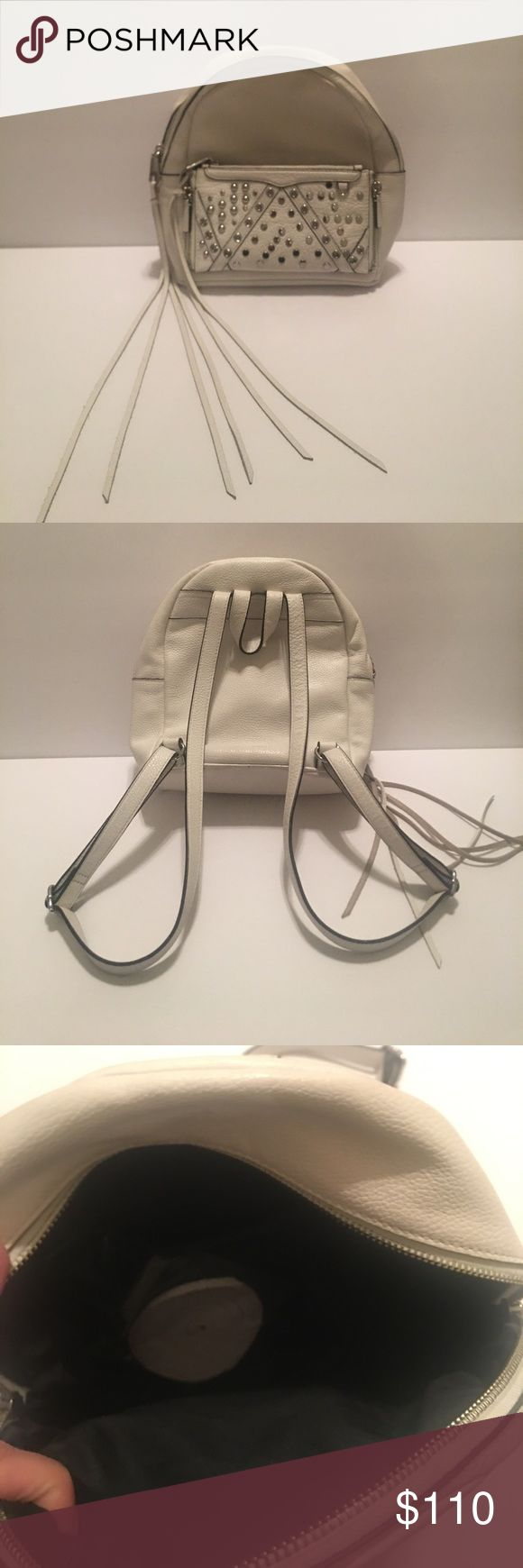 ❤️Rebecca Minkoff mini Lola backpack New with a little wear on bottom, hardly noticeable!!! Super cute mini Lola white and silver backpack with extra leather strings and reversible front piece that can turn into a wallet that attaches around your wrist!!! 👍🏻❤ 100% authentic Rebecca Minkoff Bags