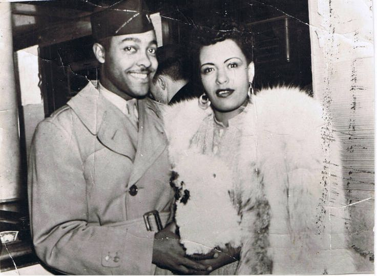 Lover Man (Oh, Where Can You Be) the song considered to be a turning point in the career of song stylist and jazz innovator, Billie Holiday, was written by a nice looking, sensitive young brotha by the name of Lt. Jimmy Davis. Lt. Davis was a Julliard-trained pianist. The lyrics were brooding and moody, and contained all the pathos that Holiday would soon become most identified with. Here, the lovely singer and the handsome songwriter are shown in a nightclub, circa 1942.)