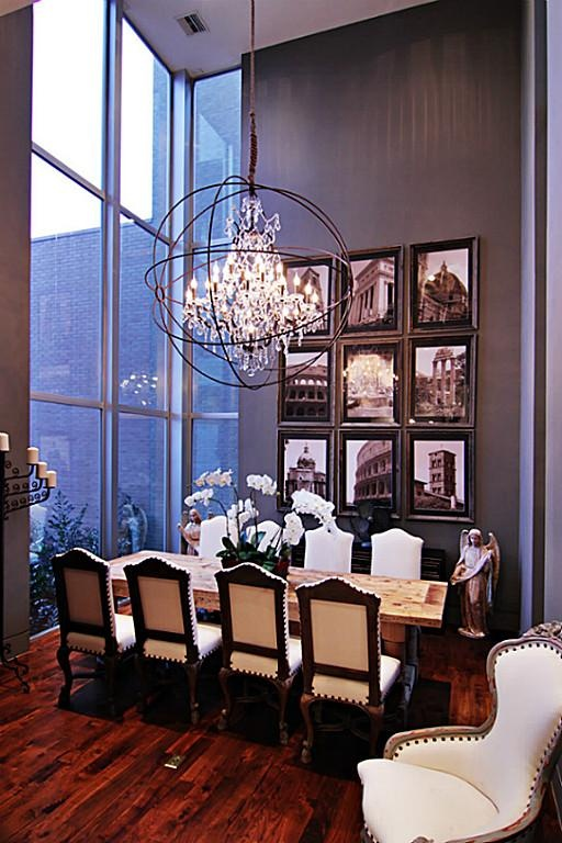 Formal dining room exhibits high ceilings floor to Floor to ceiling windows for sale