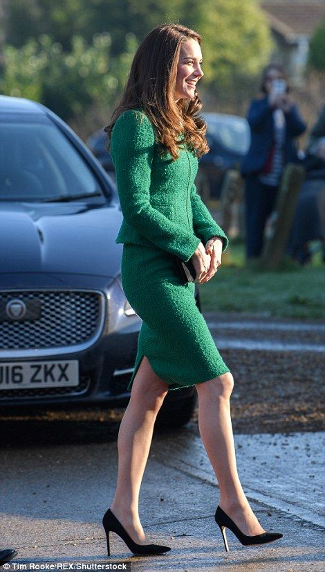 Duchess of style: Kate added a touch of glamour to her emerald green Hobbs suit...