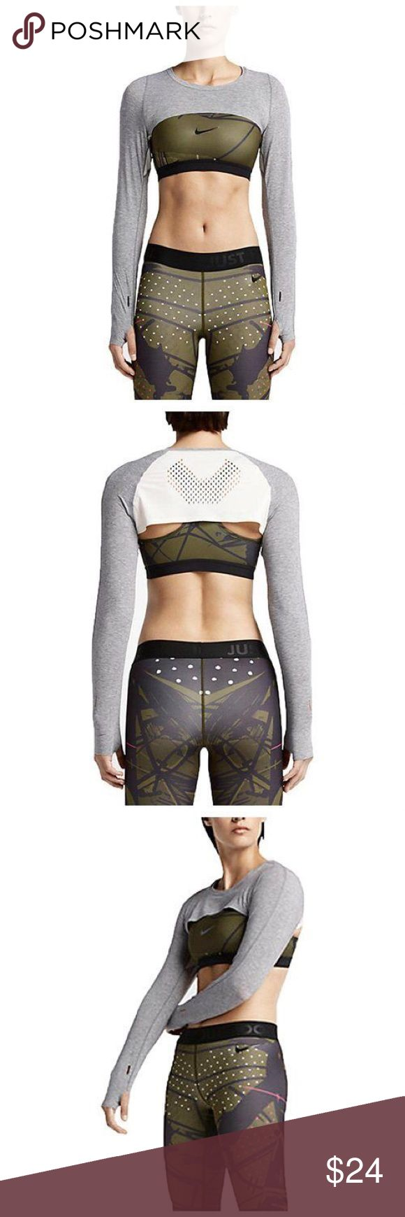 Nike Lab x JFS Laser Cut Shrug Crop Top One of my favorite Nike Lab collaborations. Every detail in the collection is designed with purpose and performance in mind. Schneider relied on Nike's expertise with innovation applications in the placement of laser-cut patterns for breathability and the use of lightweight bonded finishes.  This cropped grey shrug has thumbholes and would look great layered. Nike Tops Crop Tops